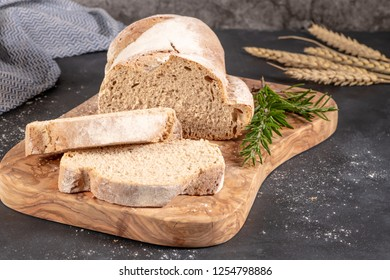 Fresh fragrant bread on the table. Food concept. Bakery, crusty loaves of bread and buns. Assortment of baked bread.