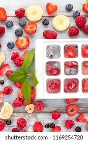 Fresh, freeze dried and frozen berry fruits from above on wooden table.