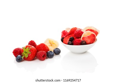 Fresh and freeze dried fruits isolated on white background.