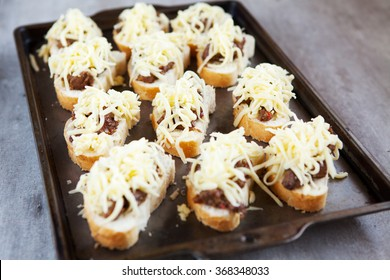 Fresh french rolls loaded with cheese and chicken livers, ready to be grilled