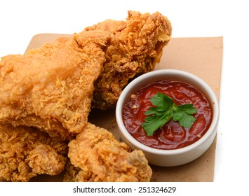 fresh fried chicken with sauce on white background