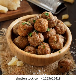Fresh fried meatballs in a bowl on a wooden table