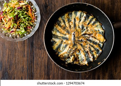 Fresh Fried Sardines / Anchovy Hamsi Tava in Pan on Wooden Surface. Seafood