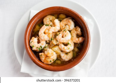 Fresh fried spanish garlic shrimp served in clay pot in local restaurant in Taganana on tropical island Tenerife, Canary in Spain. Spanish food specialities.