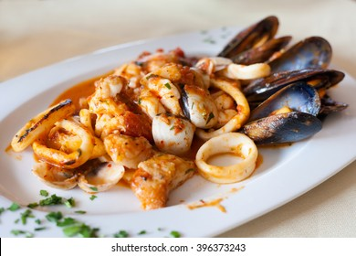 Fresh fried spicy seafood plate mixed diablitos style served in local restaurant in Los Gigantes on tropical island Tenerife, Canary in Spain. Spanish food specialities.