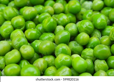 Fresh Frozen pea peas texture background. Green peas background pattern.