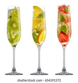 fresh fruit alcohol cocktail or mocktail in classic champagne glass with ice, strawberry, kiwi, orange and mint isolated on white background