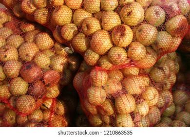 Fresh fruit, apples from garden in mesh jack, autumn harvest