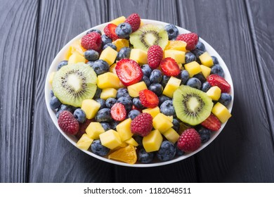 Fresh fruit and berries salad . Healthy vitamin food background .