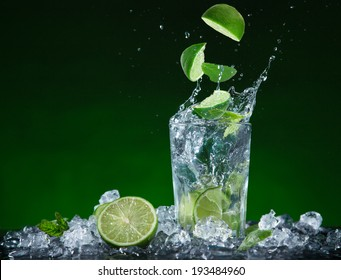 Fresh fruit cocktail in freeze motion splashing, close-up.