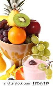fresh fruit with a glass of fresh yogurt