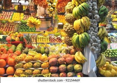 Fresh fruit at a market stall, banana and garlic