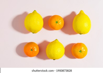 Fresh fruit on a pink background. View from above.