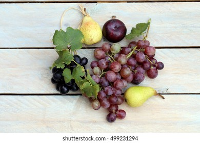 fresh fruit on the table grape, plum and pear.