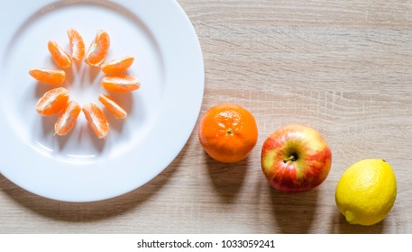 Fresh fruit plate on table. Healthy life stile concept. Roustick table.