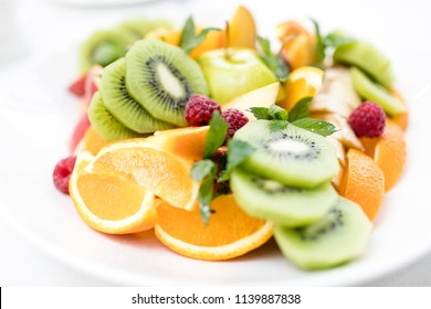 Fresh fruit salad with kiwi, apples, oranges and other berries