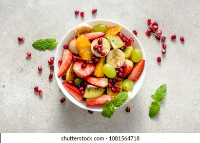 Fresh fruit salad on bright background, healthy diet concept