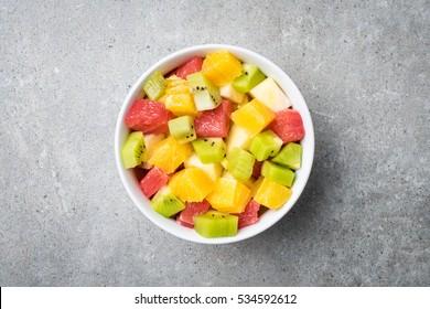Fresh fruit salad on gray stone table