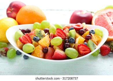 Fresh fruit salad on wooden table