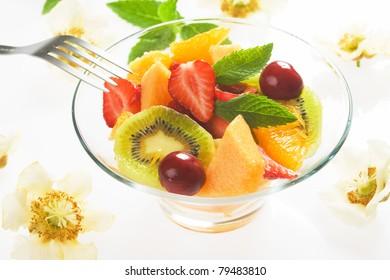 Fresh fruit salad with strawberry, kiwi, orange and melon
