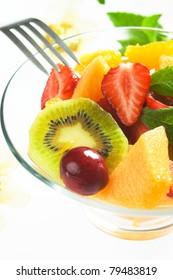 Fresh fruit salad with strawberry, kiwi, orange, cherry and melon