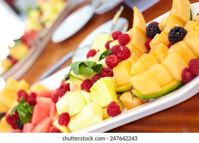 Fresh fruit salad in white plate on table