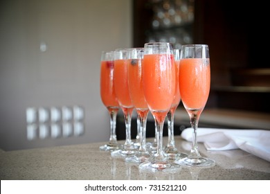 Fresh fruit strawberry, orange and champagne mimosa cocktails at a bar