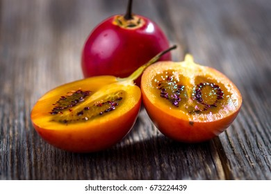 Fresh fruit tamarillo on wooden background