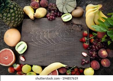 Fresh fruit. Fruit variety on wood. Food background. Tropical fruit