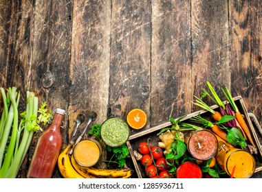 Fresh fruit, vegetable and berry smoothies. On a wooden background.