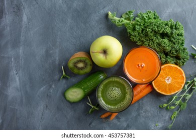 Fresh fruit and vegetable juice in the glass for detox, selective focus