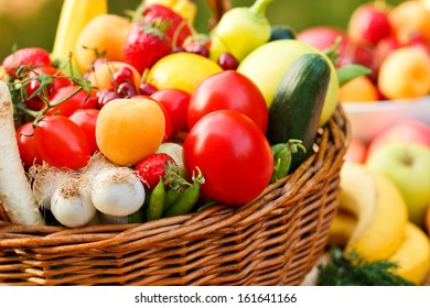 Fresh fruit and vegetables in a wicker basket