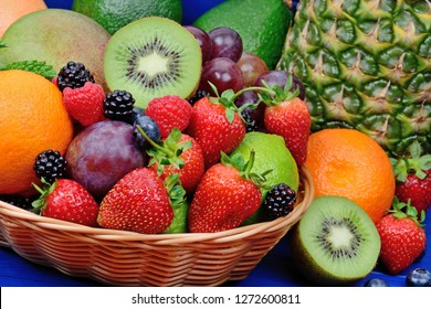 Fresh fruits in a basket on blue wooden table