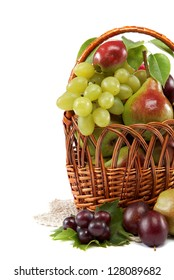 Fresh fruits in a basket on white background. Set of different.