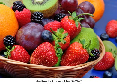 Fresh fruits in a basket on a wood table