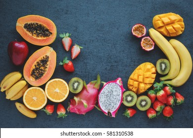 Fresh fruits. Exotic fruits on a black background