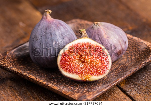 Fresh fruits, figs on the wooden plate