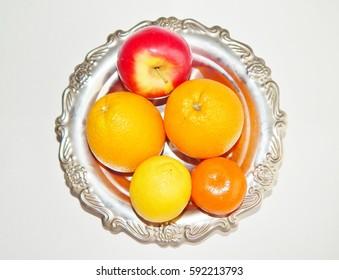 fresh fruits in an iron bowl