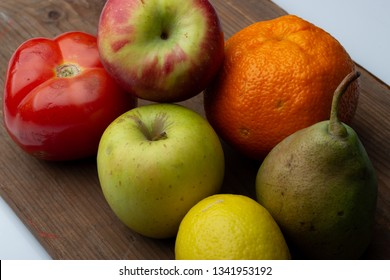 Fresh fruits isolated on wooden board