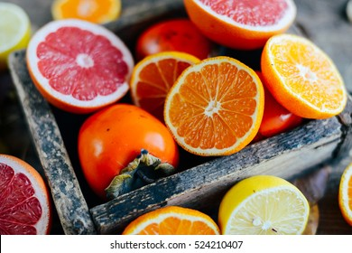 Fresh fruits. Mixed fruits background. Healthy eating, dieting. Background of healthy fresh fruits. Fruit salad - diet, healthy breakfast. pomegranate, persimmon, tangerine, banana, lemon