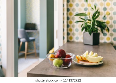 Fresh fruits on the table in the dining kitchen room, modern stulish interior design for your home
