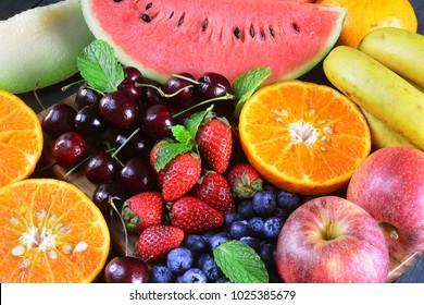 Fresh fruits on wooden background, Healthy diet.