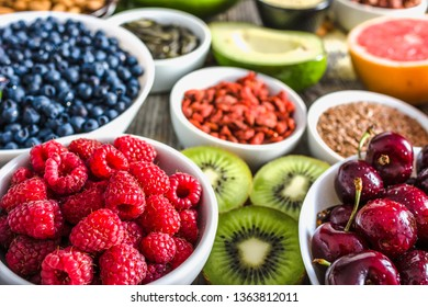 Fresh fruits and other healthy food. Organic breakfast containing super foods, vegetarian nutrition like nourishing fruit, assorted berries, raspberry, cherry, blueberry