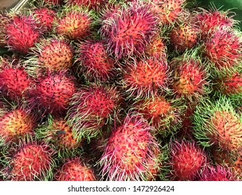 Fresh fruits rambutans background, Red rambutans and yellow rambutans in a supermarket local market, Healthy rambutans in Thailand