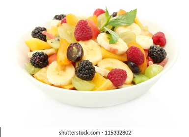 fresh fruits salad in bowl, isolated on white