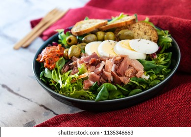 Fresh fruits salad and ham with egg