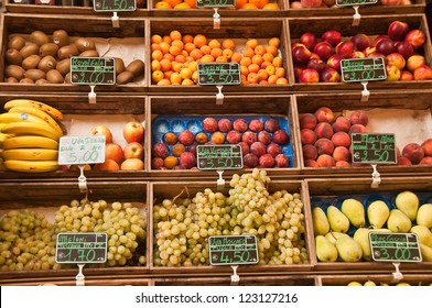 Fresh fruits stand with prices