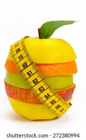 fresh fruits with tape measure and diet against overweight