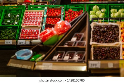 Fresh fruits and vegetables on the counter of a grocery store