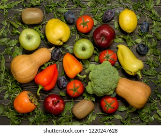 fresh fruits and vegetables on a dark wooden background